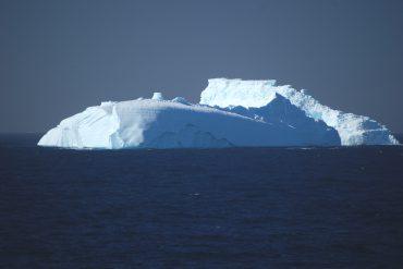 Iceberg tip in the ocean.