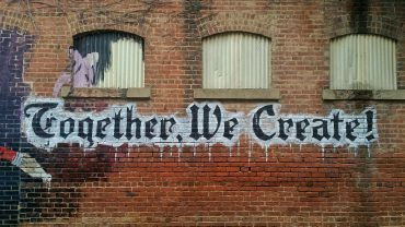 """Image of wall with words """"together we create"""" written on it"""